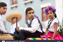 matamoros-tamaulipas-mexico-november-20-2018-the-november-20-parade-young-boy-wearing-traditional-mexican-clothing-holding-a-toy-rifle-during-t-RB0TX6